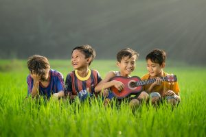 Kids enjoying music. Photo by Robert Collins on Unsplash